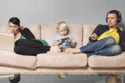 Parents and a child watching TV together