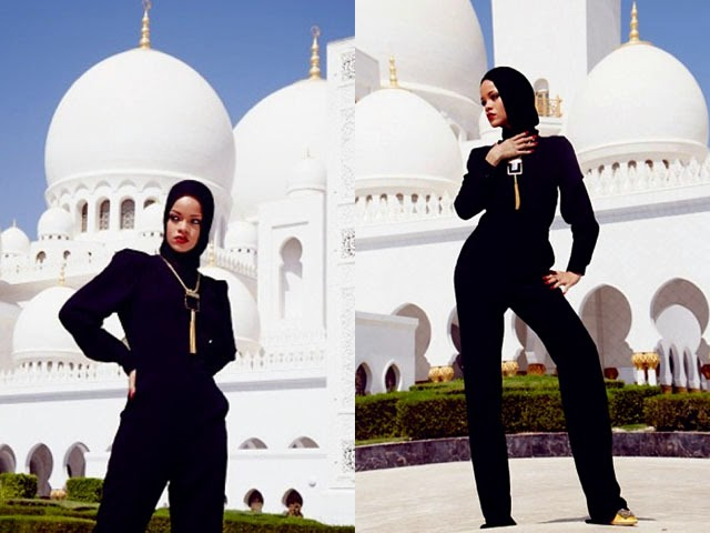 striking high fashion poses outside Shaikh Zayed Grand Mosque Centre.